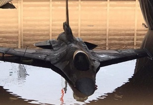 One of the badly damaged Israeli jet fighters flooded in its hangar